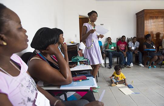 Haitian Nandie Saint Paul takes her son to class